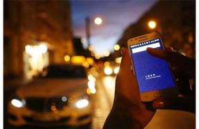 In this photo illustration, a woman uses the Uber app on an Samsung smartphone on Sept. 2, 2014 in Berlin, Germany. Adam Berry/Getty Images