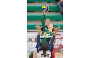 Meg Casault of the University of Alberta Pandas smashes the ball at Nikki Cornwall of the Trinity Western University Spartans during the Canada West Final Four championship final on Friday night at the Saville Community Sports Centre.