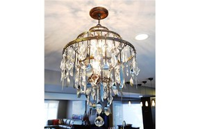 Cutlery adorns this dining room chandelier from Park Lighting.