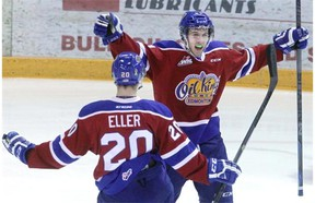 Edmonton Oil Kings forward Tyler Robertson celebrates a goal on the Brandon Wheat Kings with teammate Mads Eller 11 seconds into Game 1 of their Western Hockey League Eastern Conference quarter-final series on Thursday, March 26, 2015, at Westman Place in Brandon, Man. The Oil Kings won the game 4-1.