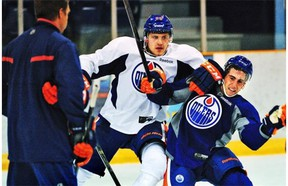 Edmonton Oilers' first-round draft pick Leon Draisaitl, left, knocks down defenceman Joey Laleggia during the NHL team's annual prospects development camp on July 3, 2014, at Jasper.