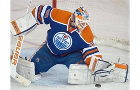 Goalie Ben Scrivens (30) makes a save as the Edmonton Oilers play the Toronto Maple Leafs at Rexall Place in Edmonton on March 16, 2015.