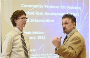 Kevin Cameron (left), trainer from the Canadian Centre for Threat Assessment and Trauma and Frank DeAngeles, retired principal from Columbine school, at a training session for dozens of school district principals and other administrators to recognize safety threats in schools at the Executive Royal Inn in Nisku on Thursday Mar. 5, 2015.