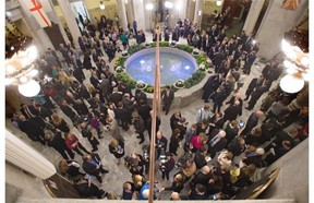 The rotunda is packed with media, politicians, etc. after the Alberta Budget 2015 was tabled at the Legislature in Edmonton, March 26, 2015.