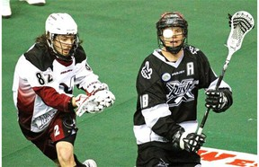 Edmonton's Rush's Zack Greer, right, and Colorado Mammoth's Joey Cupido keep their eyes on the ball during a National Lacrosse League game at Rexall Place on April 18, 2015.