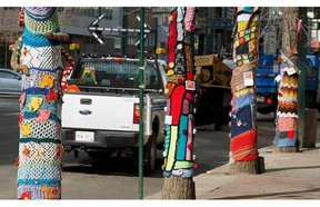A pedestrian walks by yarn bombing on Jasper Avenue, west of 102 Street in downtown Edmonton on Wednesday April 30, 2014
