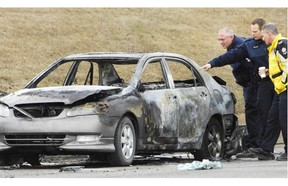 Shernell Pierre's burned car along 170th Street. FILE