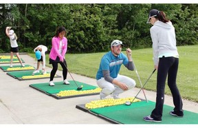 Assistant pro Adam Bruce gives junior golfers tips on driving during a CN Future Links girls' clinic at the Glendale Golf & Country Club in Edmonton, one of many development programs for children in Alberta. Junior golf is seeing unprecedented growth in the province.