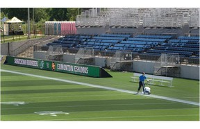 FORT MCMURRAY, ALBERTA ; JUNE 12, 2015--Sports Fields Supervisor, Jay Michaluk paints the lines at SMS Equipment Stadium on June 12, 2015, in Fort McMurray. The stadium is brand new and will host a CFL game between the Edmonton Eskimos and the Saskatchewan Roughriders on Saturday. (Greg Southam/Edmonton Journal)