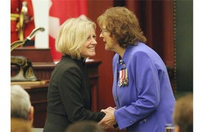 Lieutenant-governor Lois Mitchell (right) is congratulated by Alberta Premier Rachel Notley (left) after being installed as Alberta's new Lieutenant-Governor at the Alberta Legislature on June 12, 2015.