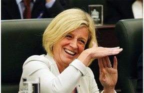 Premier Rachel Notley jokingly calls for a time out during the opening of the 29th Alberta Legislature in Edmonton on Thursday, June 11, 2015.