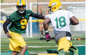 Cornerback Patrick Watkins, wearing No. 9 at left, takes part in a drill during Edmonton Eskimos training camp at Spruce Grove's Fuhr Sports Park on June 15, 2015.