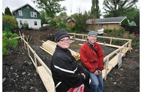 Karly Coleman, left, and Andy Hegst on the site of the future net zero garage suite in their west side home's backyard.
