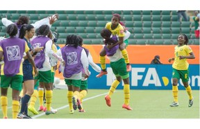 Madeleine Ngono Mani (9) celebrates her winning goal, jumping into a teammate's arms as Cameroon defeats Switzerland 2-1 in a Group C Women's World Cup match at Commonwealth stadium.