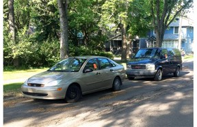Two cars towed and left on 106th Avenue, near 128th Street. Cliff's Towing says the central neighbourhood is a convenient place to leave cars it has towed from the downtown core at the city's request.