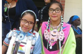 Kyra Morin, 10, and Kimana Gillis, 12, get ready for the round dance at Parkdale School in northwest Edmonton to celebrate this weekend's National Aboriginal Day.