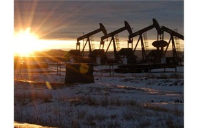 In this Jan. 14, 2015 file photo, some of the 60 rigs that are drilling surrounding McKenzie County, 40 percent of the rigs statewide, work in western North Dakota.