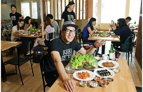 John Anh, owner of the Nongbu Korean Eatery, with some of the restaurant's popular dishes