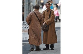 At least five men dressed as monks approached people on Jasper Avenue asking for money donations in Edmonton on Tuesday Aug. 18, 2105. It is not an accepted form of Buddhism, an Edmonton Buddhist says.