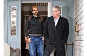 Omar Khadr and his lawyer Dennis Edney come out of Edney's house on Thursday May 7, 2015.