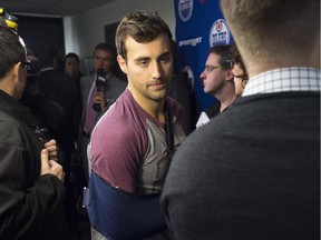 Jordan Eberle speaks with the media with his right arm in a sling as the players practice. Eberle will be out of the lineup for four to six weeks with a shoulder injury. The Oilers are practising on Wednesday at the Royal Glenora Rink.