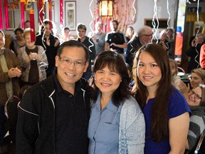 From left, Thai Tang,  Ellen Luc and their daughter Susan Tang pose for a photo during a farewell party at Happy Garden restaurant, in Edmonton Sept. 27, 2015.