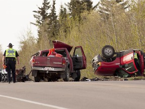 Edmonton police officers inspect the scene of a fatal crash on 50th Street near 41st Avenue on May 21, 2014.