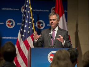 In this February 2015 file photo, then-Premier Jim Prentice gestures during his keynote address to the U.S. Chamber of Commerce in Washington, D.C.