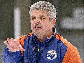 Edmonton Oilers head coach Todd McLellan directs a drill during training camp in Leduc, Alta., on Friday, Sept. 18, 2015.