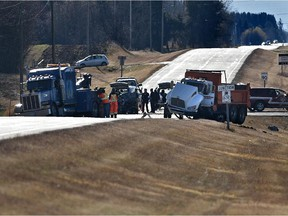 A gravel truck heading north on Golden Spike Road collided with a pickup westbound on  Highway 628 near Spruce Grove on Saturday. Three people in the pickup were killed.
