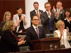 Alberta Finance Minister Joe Ceci, centre, receives a round of appause after delivering the 2015 provincial budget at the Legislative Assembly in Edmonton on Tuesday, Oct. 27, 2015.