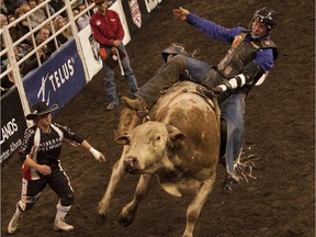 Tyler Thomson hangs on during the bull riding at the 2014 Canadian Rodeo Finals. The future of the event in Edmonton is up in the air.