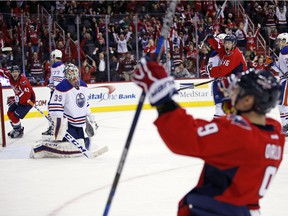 Edmonton Oilers goalie Anders Nilsson (39), from Sweden, watches as Washington Capitals defenseman Dmitry Orlov (9), from Russia, celebrates his game-winning goal, with Capitals right wing Tom Wilson (43) and Capitals center Michael Latta (46) nearby, in the third period of an NHL hockey game, Monday, Nov. 23, 2015, in Washington. The Capitals won 1-0.