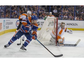 Taylor Hall of the Edmonton Oilers, tries a wraparound on Michal Neuvirth of the Philadelphia Flyers at Rexall Place.