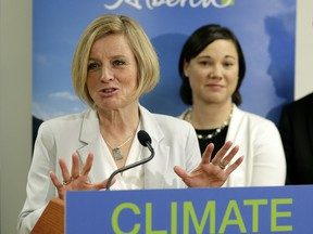 Alberta Premier Rachel Notley (left) and Alberta Minister of Environment and Parks Shannon Phillips released details about Alberta's Climate Leadership Plan at the Telus World of Science in Edmonton on Sunday November 22, 2015.