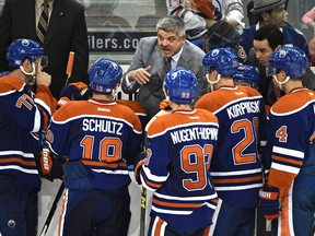 Edmonton Oilers head coach Todd McLellan talks to his players during a game against the Detroit Red Wings  at Rexall Place on Oct. 21, 2015.