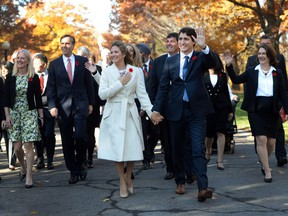 Prime Minister-designate Justin Trudeau and his wife Sophie Gregoire-Trudeau walk to Rideau Hall with Trudeau's future cabinet to take part in a swearing-in ceremony in Ottawa on Nov. 4, 2015.