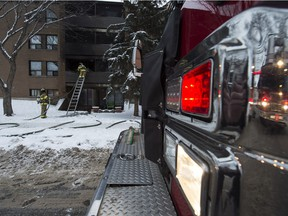Firefighters put out a fire in a McCauley neighbourhood apartment building on Wednesday, Dec. 16, 2015.