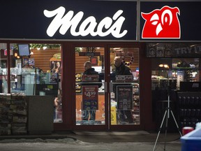 Police investigate the scene of a murder at a Mac's Store at 108 Street at 61 Avenue in the early morning hours in Edmonton on Friday Dec. 18, 2015.
