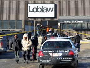 Employees leave the Loblaw warehouse after Jayme Pasieka went on a stabbing rampage on Feb. 28, 2014. Pasieka was found guilty on March 3, 2017, of two counts of first-degree murder and four counts of attempted murder in the attack.