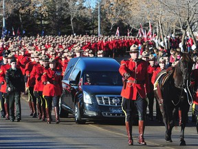 RCMP officers attend the funeral procession for slain RCMP Constable David Wynn, in St. Albert on Jan. 26, 2015.