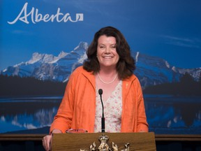 Jobs Minister Lori Sigurdson smiles during a June 29, 2015 news conference in Edmonton to announce that Alberta's minimum wage will be increased to $15 per hour by 2018.