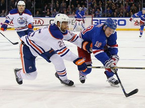 Darnell Nurse of the Edmonton Oilers checks Jesper Fast of the New York Rangers during the second period at Madison Square Garden on Dec. 15, 2015 in New York City.