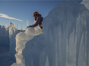 Ice Pixie Melissa Wolfinger places icicles on the walls of Edmonton's Ice Castle. Shaughn Butts/ Edmonton Journal