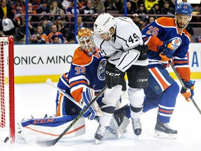 Edmonton Oilers defenceman Darnell Nurse helps goalie Cam Talbot stop Los Angeles Kings' Michael Mersch during an NHL game at Rexall Place on Dec. 29, 2015.