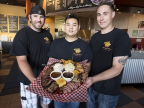 Memphis Blues Barbeque House manager Mike Byers (left) along with owners Jonathan Ip (middle) and James Braun (right)