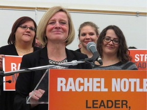 Alberta Premier Rachel Notley speaks to party members at MacEwan University, in Edmonton, on Saturday, Dec. 12, 2015. Notley said her government made mistakes communicating the details of its controversial farm-safety bill, but said the intent is ultimately what matters. The bill, passed by Notley's NDP government this week, delivers health and safety and workers' compensation benefits to all paid farm workers.