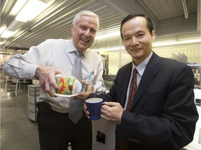 BioNeutra Senior Vice President Bill Smith and BioNeutra President and CEO Jianhua Zhu poses for a photo at BioNeutra's production plant, 9608 - 25 Ave., in Edmonton Alta. on Tuesday Feb. 23, 2016. The company has developed a prebiotic low-calorie sweetener called VitaFiber. Photo by David Bloom Former Edmonton mayor Bill Smith now a biotech entrepreneur
