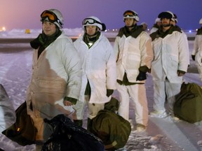 Paratroopers with the 3rd Canadian Division Princess Patricia Canadian Light Infantry (3 PPCLI) prepare to board a CC-150J Hercules aircraft en route to Resolute Bay, NU on Friday, February 12, 2016.