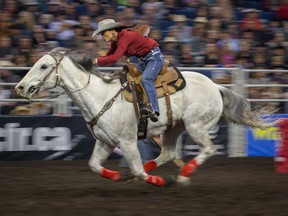 Julie Leggett competes in the ladies barrel race at the Canadian Finals Rodeo at Rexall Place in Edmonton on November 11, 2015.